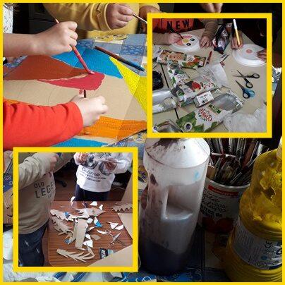 Os alunos pintam a base de cartão enquanto outros recortam as embalagens de sumo compal e outros recortam pormenores de papelão para compor a máscara.