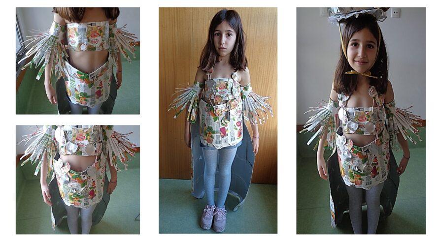 Visualização da máscara (frente) na modelo/ aluna do 3º ano de escolaridade (top, saia, braçadeiras e colar).